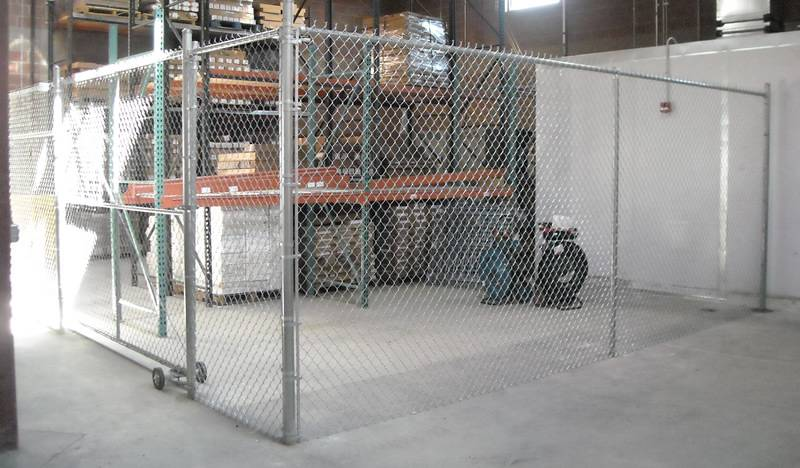 An indoor chain link fence for a temporary enclosure.