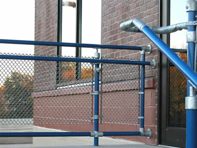 Chain Link Stair Railing With Blue Tension Bar And Blue Top Rail.