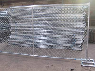 Galvanized chain link fence panel with vertical bracing.