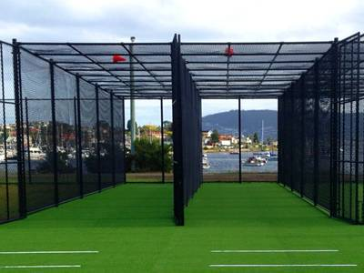 Black cricket chain link net fencing blends well into the surroundings.