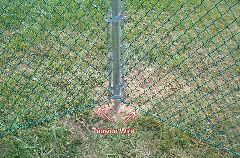 Tension wire of farm chain link fencing add security.