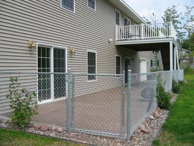 Galvanized residential fence with single walk gate.