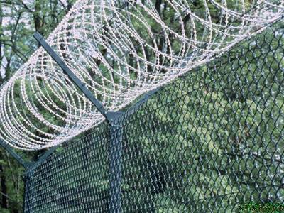 Razor wire and barb wire over chain link fence for the best security.