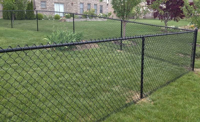 4 ft. tall black polymer-coated chain link fence around a house.