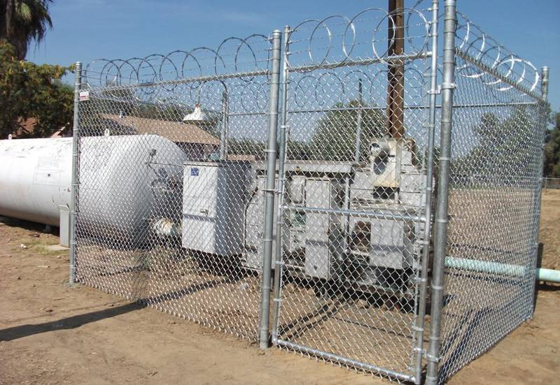 Important equipment enclosed by high security chain link fence.