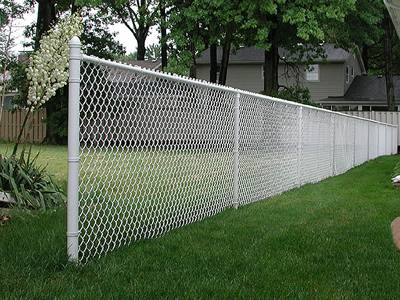 White vinyl-coated chain link fence for residential area.