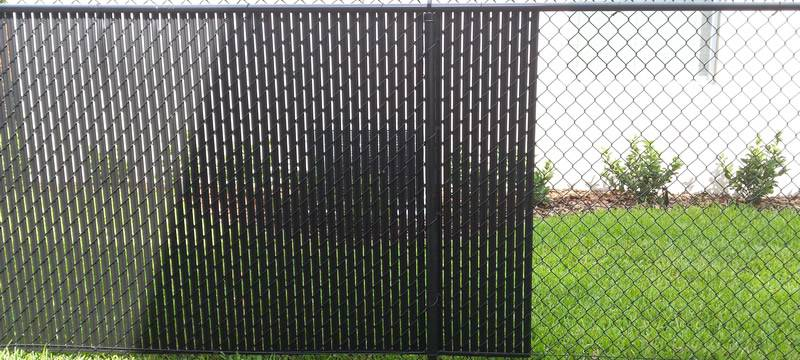 Black single wall bottom locking slats for black chain link fence.