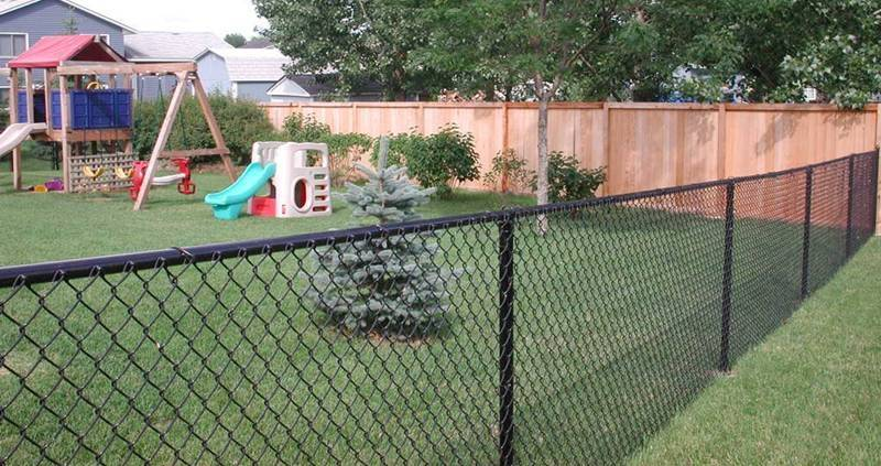 4-feet high black vinyl-coated chain link fencing for a playground.