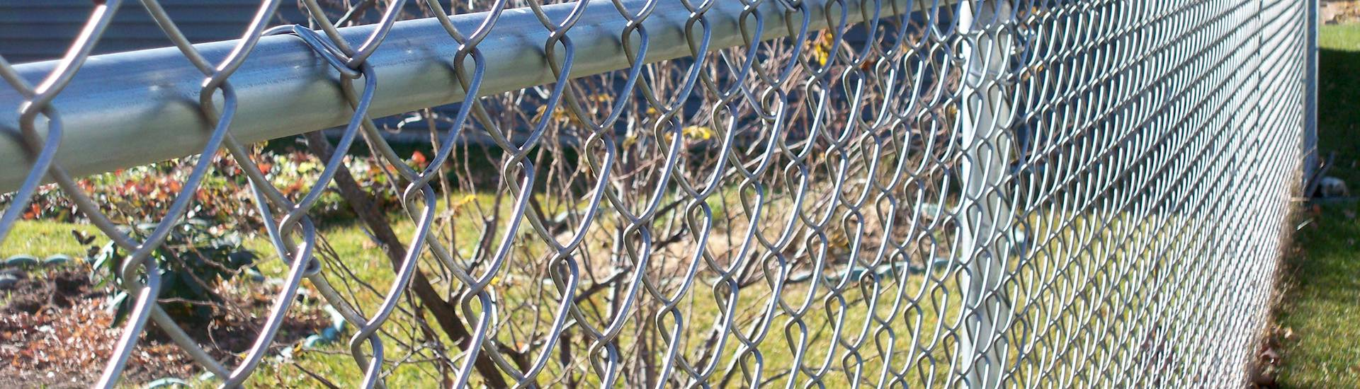Galvanized chain link fences are installed in the backyard.