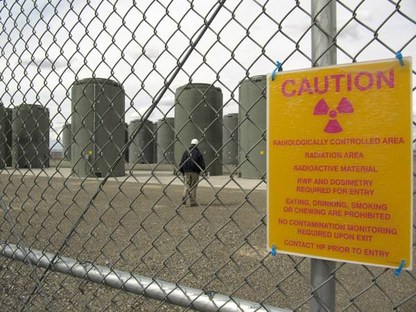 A warning sign posted on the chain link fence of nuclear power plant.