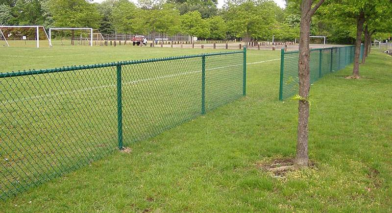 4-ft high green PVC-coated chain link fence around a sport filed.