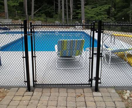 Chain link fence is installed surround the swimming pool.