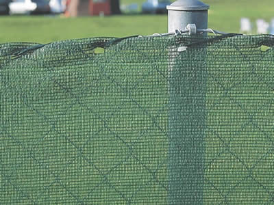 Chain link windbreak fencing consists of chain link fence and light green woven fabric mesh with rond steel posts.