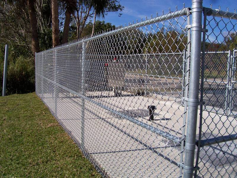 A commercial chain link fence with twisted selvage on top.