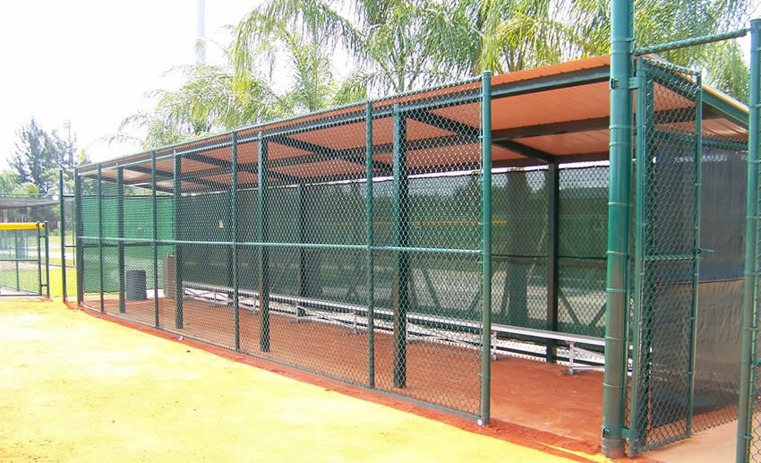 Chain Link Fences Afford Security To People And Player In Baseball Court