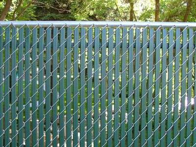 Green double wall top locking slats for yard fencing.