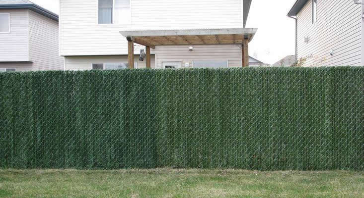 Hedge slat privacy fence for a residential area.