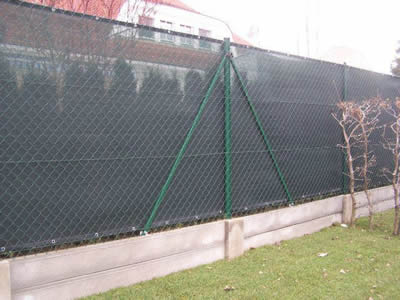 Windscreen fencing was make of chain link fence and black woven fabric mesh near the residential area.