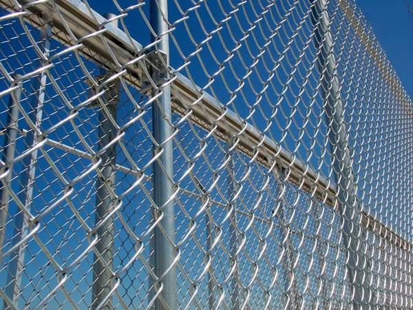 Stainless steel chain link fences are installed on the steel frames.