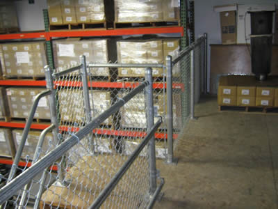 Galvanized stair chain link railing used in warehouse.